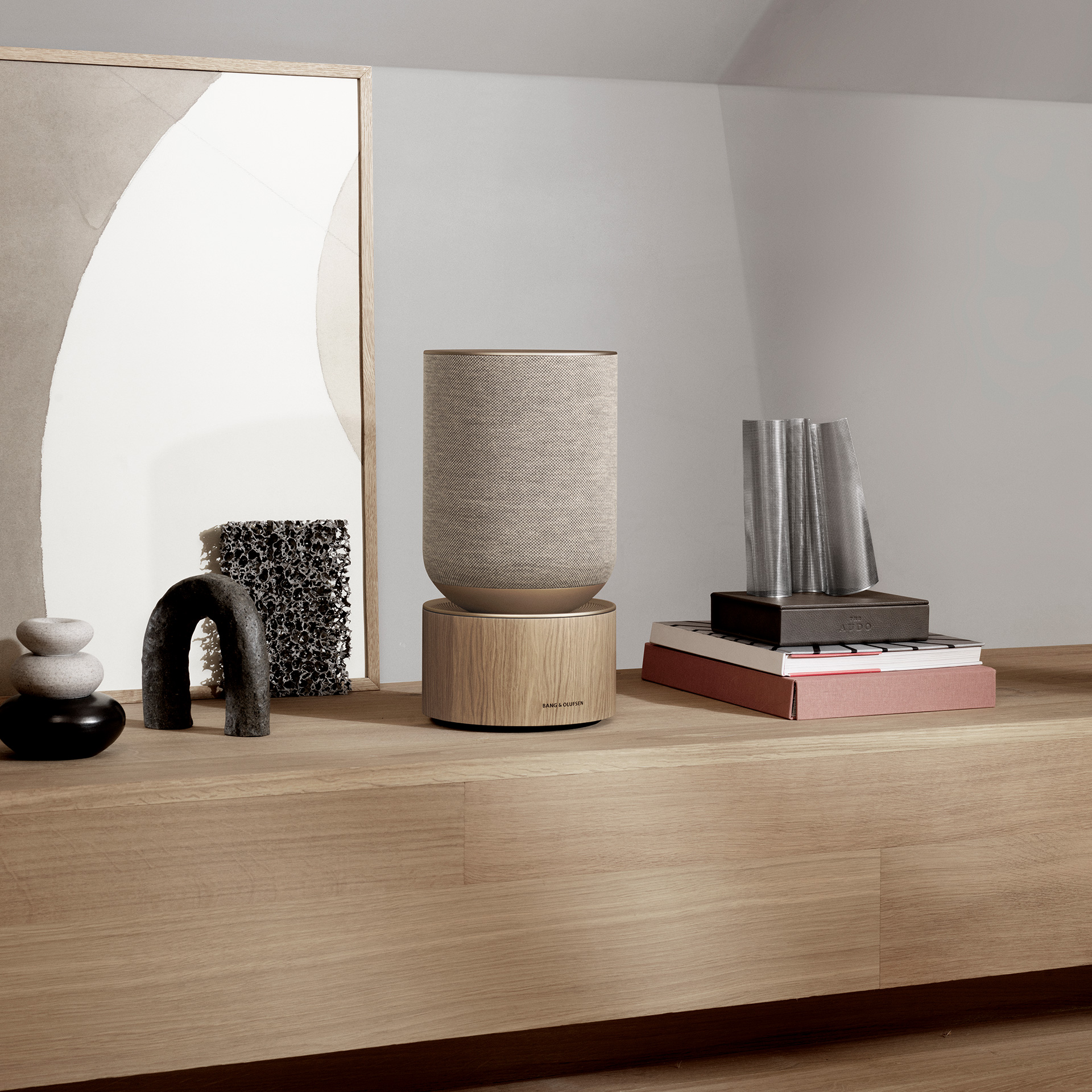 Beosound Balance Natural oak on a wooden shelf