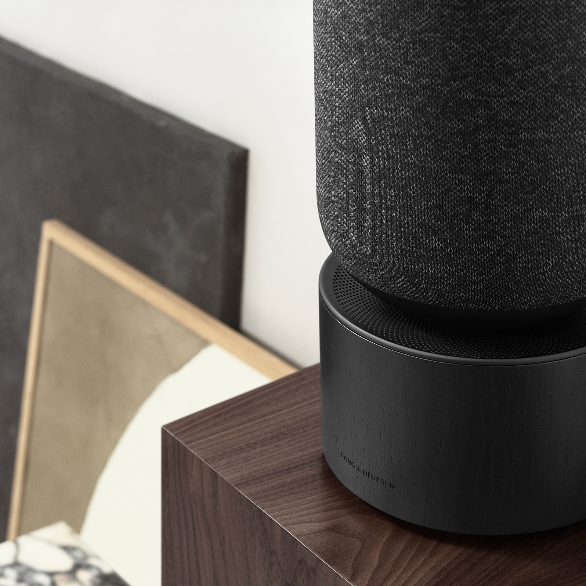 Beosound Balance Black on wooden shelf